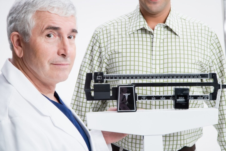 Doctor taking a patient's weight