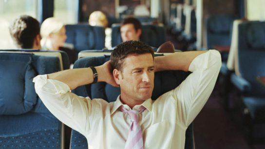 Business passenger on commuter train
