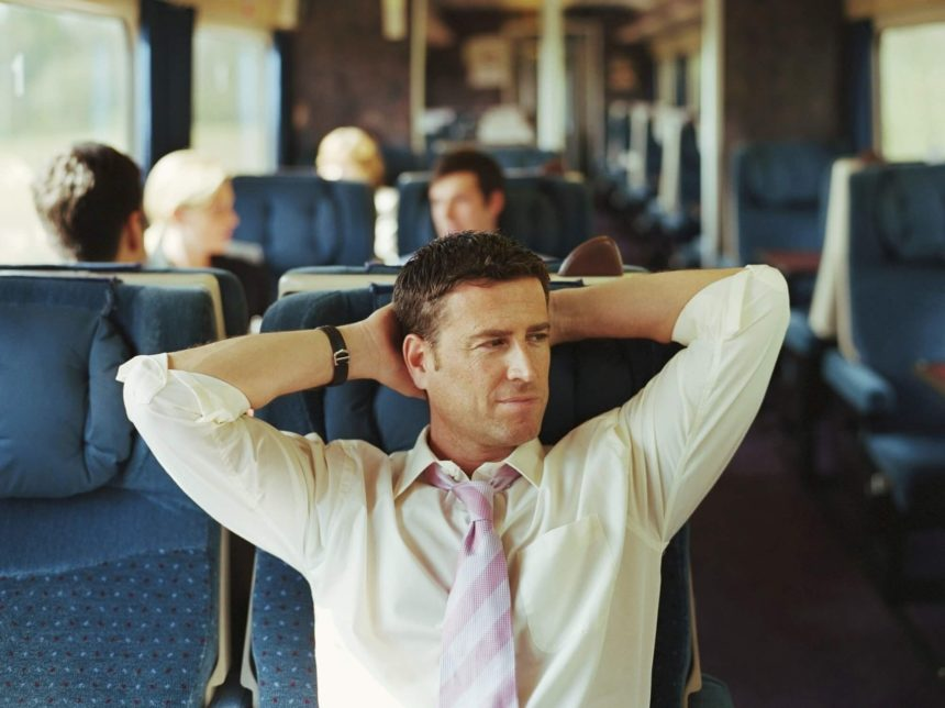Business passenger on commuter train