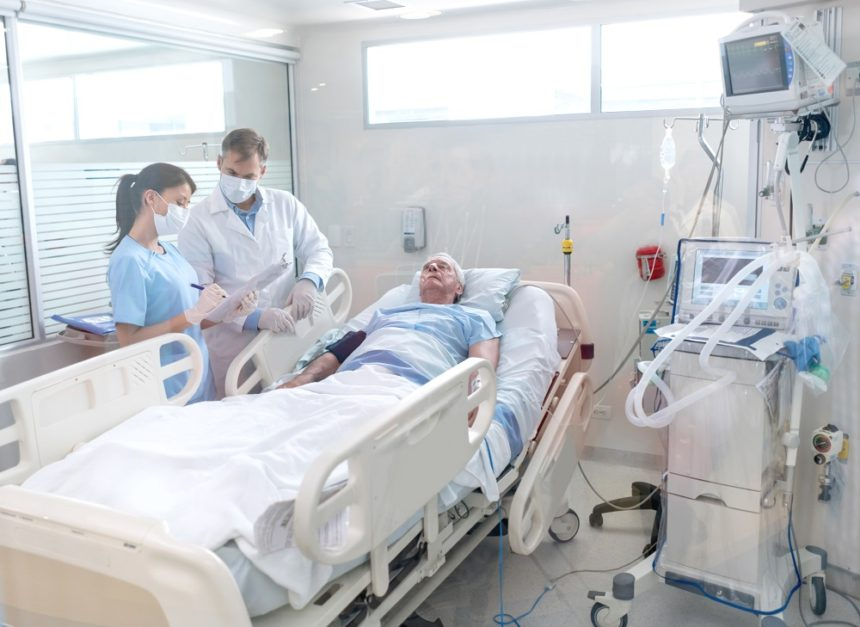 Health care team visiting patient in hospital bed