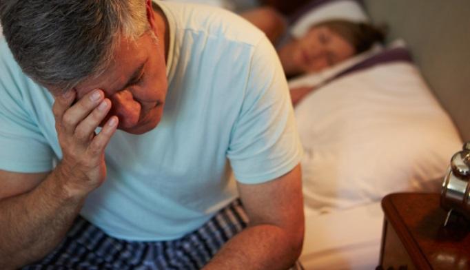 senior man waking up at night