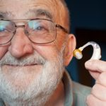 Elderly man with a hearing aid