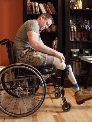 A mistake made during routine surgery led to this officer losing both his legs.