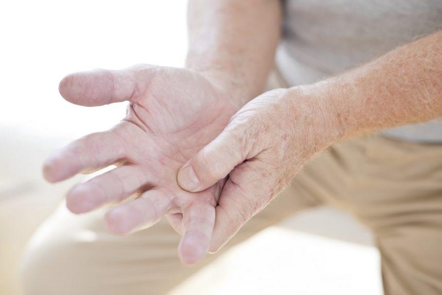 Man rubbing hand