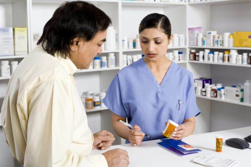 pharmacy pharmacist with patient