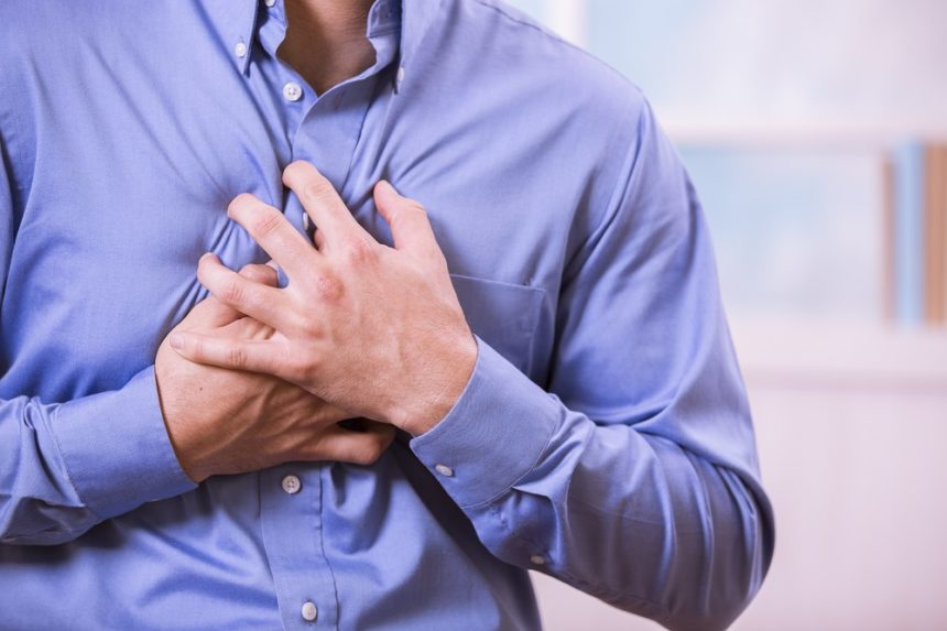 heart failure patient clutching chest