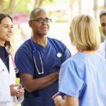 doctors talking outdoors