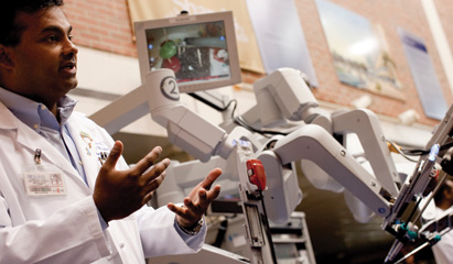 Sijo Parakattil, MD, and the robotic system he uses to perform RAVV.