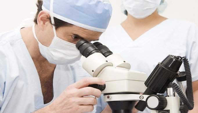 doctor-with-microscope-0516
