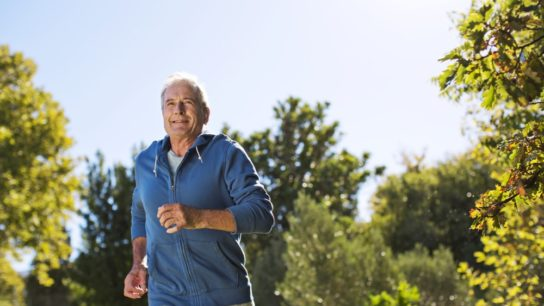 Elderly man jogging outside
