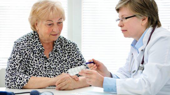 doctor senior patient pills talk