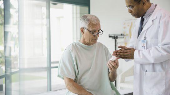 Doctor talking to older patient