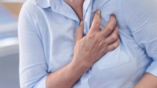 Myocardial infarction, woman clutching chest