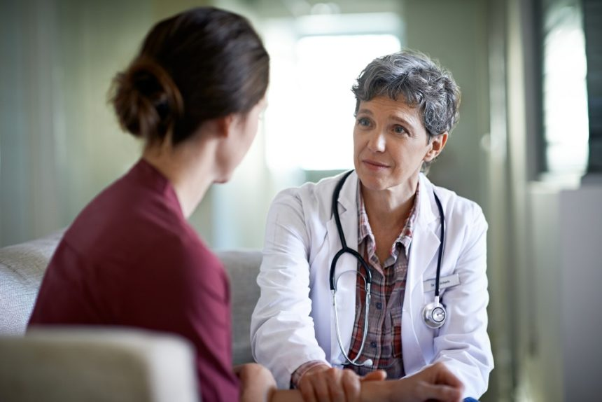 doctor giving hard news to a woman