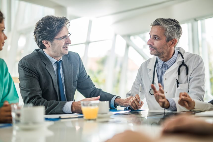 Businessman talking to doctor