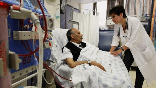 Doctor talking to dialysis patient
