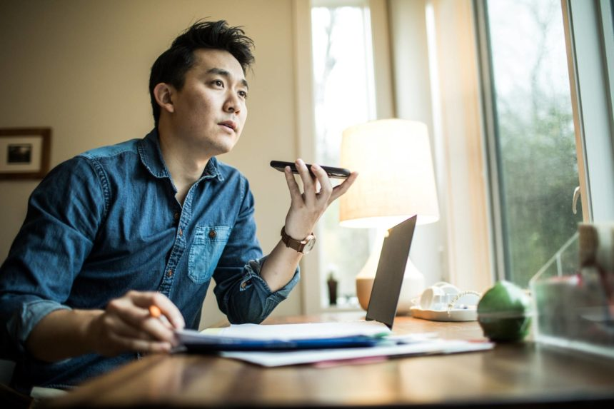 Asian young man working from home