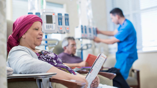 Patients and doctor in infusion room