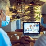 Senior couple consulting with a doctor via telemedicine