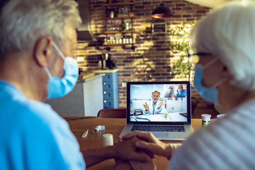 Senior couple consulting with a doctor via telemedicine