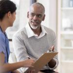 Male patient talking to nurse.